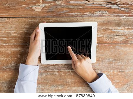 business, education, people and technology concept - close up of female hands pointing finger to tablet pc computer black blank screen on table
