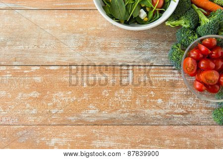 healthy eating, vegetarian food, advertisement and culinary concept - close up of ripe vegetables on wooden table