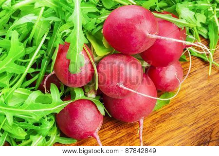 Bunch of red radishes with greens around