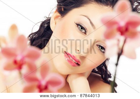 Woman Behind Orchids