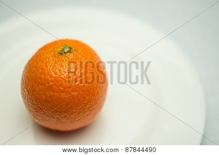 Mandarin On A White Plate