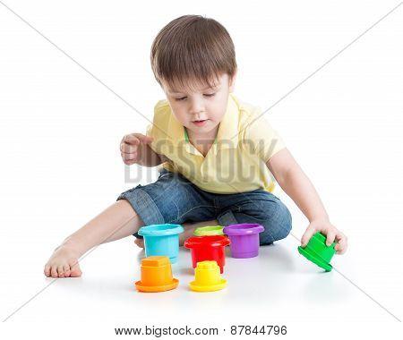 little boy playing with cup toys
