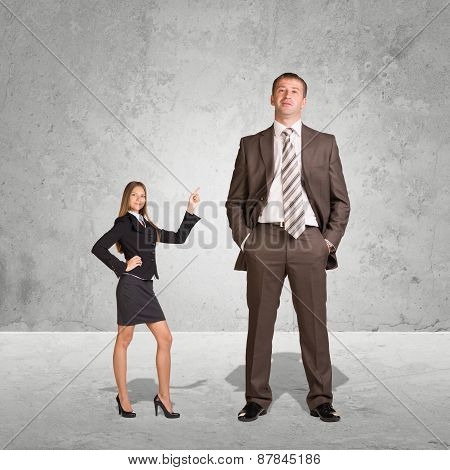 Small Young Businesswoman and Large Businessman