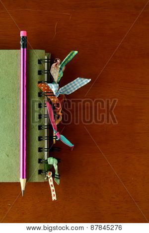 Colorful Notebook and a Pencil
