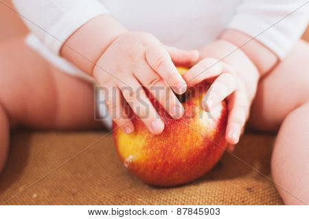Little Baby Is Holding Red Apple