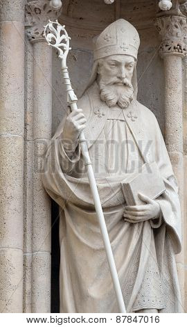 ZAGREB, CROATIA - APRIL 04: Statue of Saint Cyril on the portal of the cathedral dedicated to the Assumption of Mary and to kings Saint Stephen and Saint Ladislaus in Zagreb on April 04, 2015