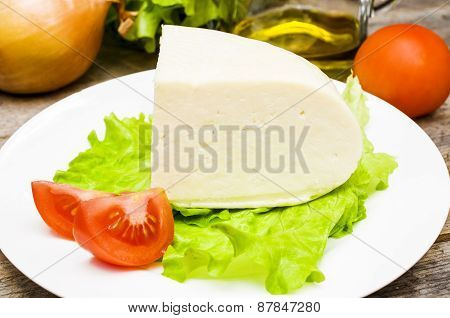 Soft Goat Cheese In A Bowl On A Wooden Table With Vegetables