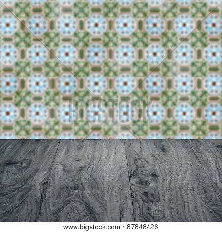 Wood Table Top And Blur Vintage Ceramic Tile Pattern Wall