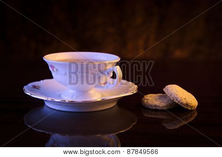 Old-style Image Cup Of Tea With Cookies On Black
