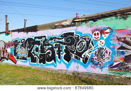 Graffiti With Chaotic Patterns And Black Text