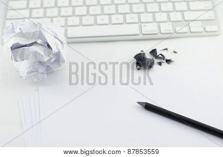 Pencil, White Paper, And Computer Keyboard On Top Of White Table With Copy Space