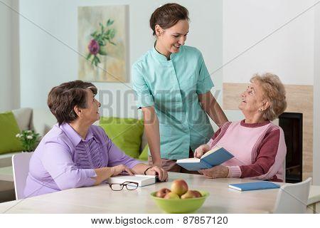 Two Elderly Women And A Friendly Nurse