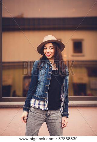 Stylish Girl Standing Near The Windows
