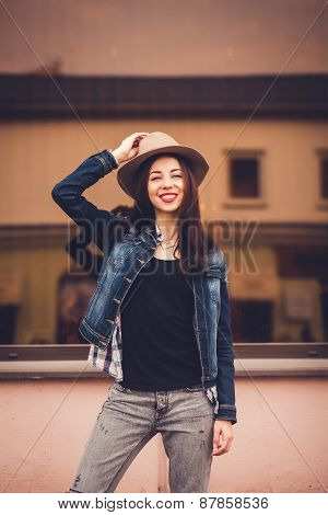 Fashion Girl In Hat And Jeans