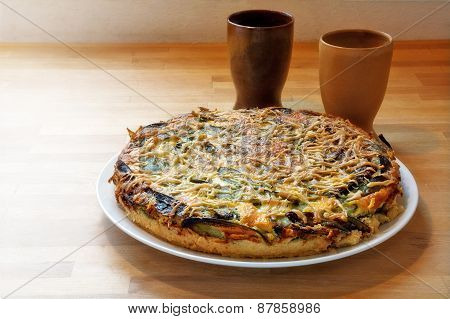 Quiche With Spinach And Vegetables On Wood