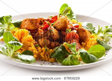 Roasted meat with pearl barley and vegetables on white background