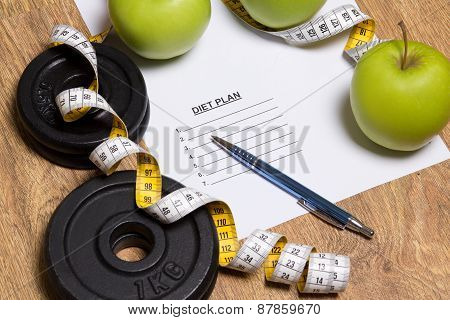 Sheet Of Paper With Diet Plan, Apples And Dumbbell