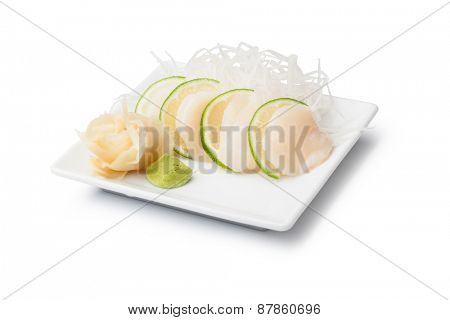 scallops sashimi with withe plate isolated on white background