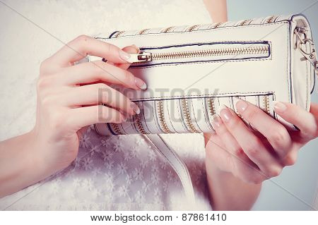 Female Hands With Manicure With Small White Handbag