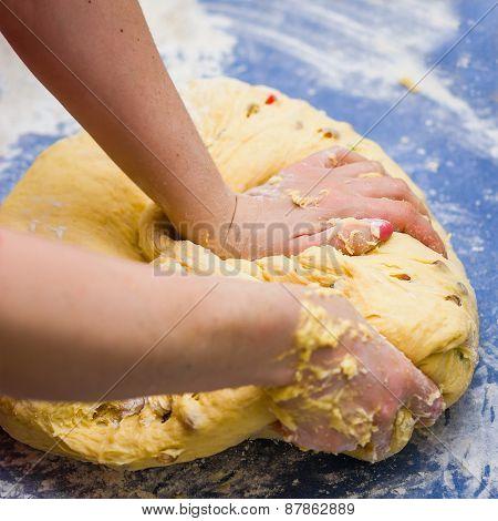 hands knead dough