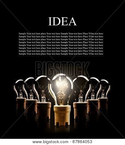 Light bulbs in rows with single one shinning, isolated on black background