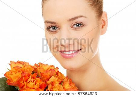 Smiling spa woman with fresh roses.
