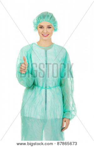 Happy female doctor with thumbs up.