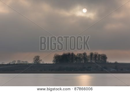 Frozen Lake At Sunrise Or Sunset. Winter Tranquil Landscape.