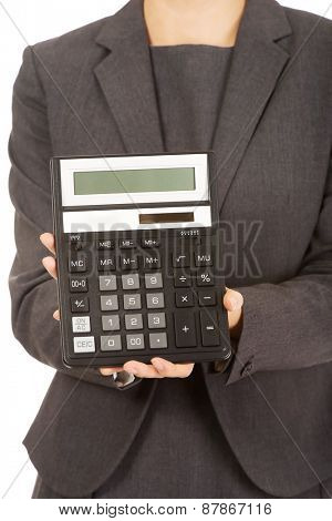 Business woman's hand with a calculator.
