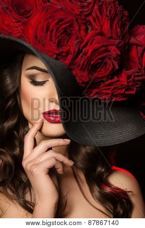 Portrait Of A Beautiful Woman With Red Roses In Hat. Red Lips. Beautiful Hair.