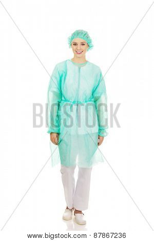 Happy female doctor in protective clothing.