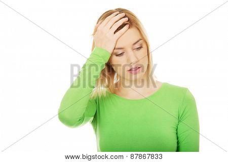 Beautiful woman suffering from headache.