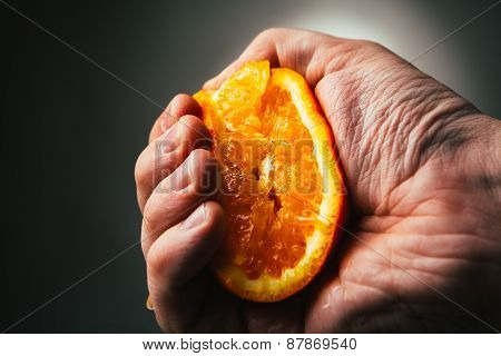Man Dramatic Squeezes Orange. Conceptis Tired From Work.
