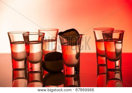 Red Cocktail In Shot Glasses