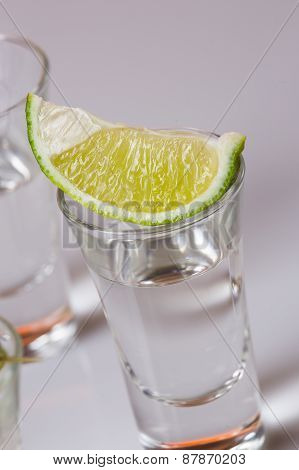 Tequila In Glass On White