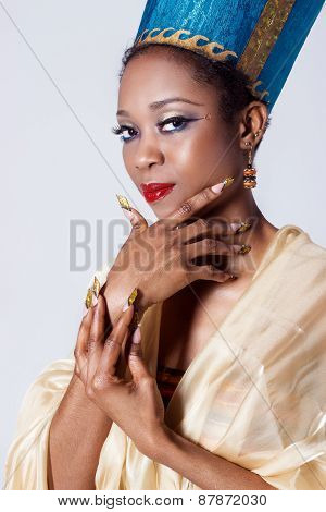 beautiful dark-skinned girl black woman in the image of the Egyptian queen with red lips bright make