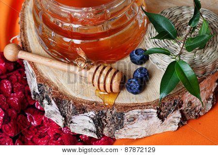 rustic honey with a spoon on birch saw cut beautiful still life of health