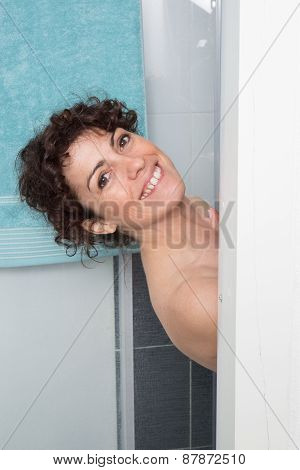 Woman With Curly Hair Standing On A Shower In A Bathroom