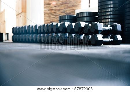 Closeup image of a fitness gym with dumbbells
