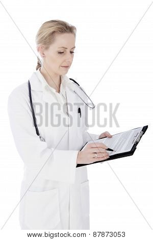 Serious Female Doctor Writing Diagnosis On Paper