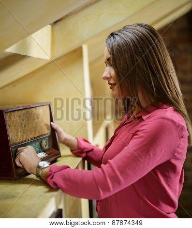 Woman Listening To A Retro Radio
