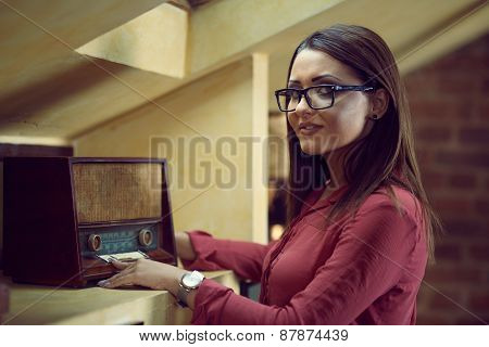 Beautiful Woman With Specs Listen To An Old Radio