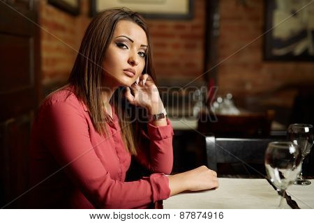 Sad Woman In A Restaurant