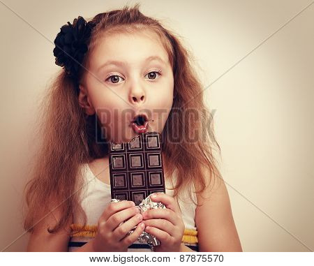 Surprised Funny Girl With Open Mouth Holding Chocolate. Closeup
