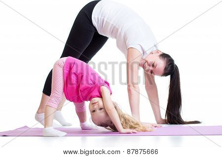 Mother and child doing exercise at home