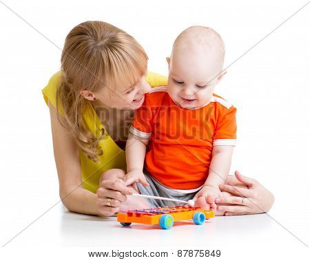 smiling child and mom playing with musical toy