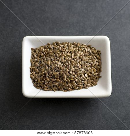 Flax Seeds In Bowl On The Table