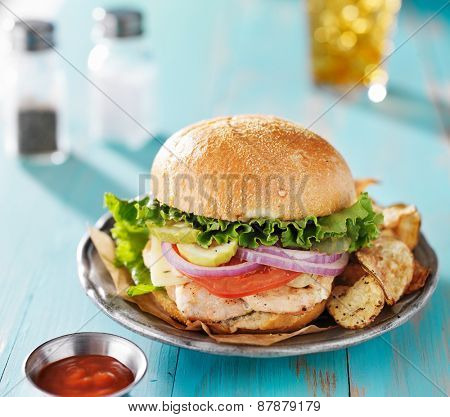 grilled chicken sandwich on rustic painted table top