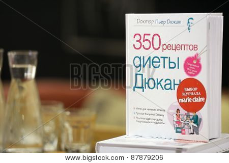 MOSCOW, RUSSIA - JULY 30, 2013: Books of French dietitian Dr. Pierre Dukan during his meeting with readers of the magazine Marie Claire in Moscow, Russia on July 30, 2013