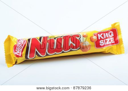 DNEPROPETROVSK, UKRAINE - SEPTEMBER 18, 2012: Chocolate bar Nestle Nuts King Size isolated on white background. Every hour 7000 chocolate bars Nuts are eaten in Russia